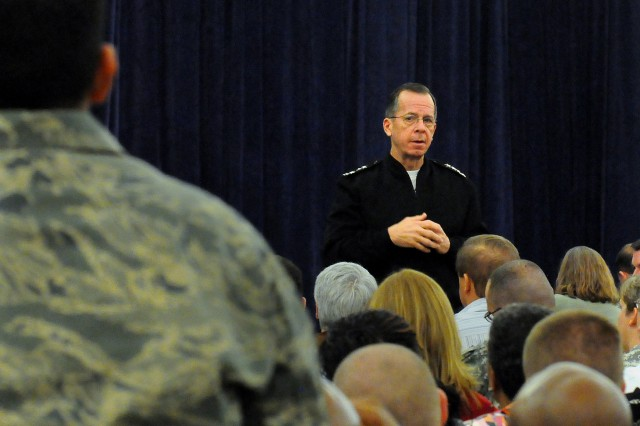 Chairman of the Joint Chiefs of Staff Adm. Mike Mullen, answers a question from an  audience member, Feb. 19, during a town hall style meeting in the Scott Club at Scott Air Force Base, Ill.  Mullen visited USTRANSCOM where he met with Gen. Duncan J. McNabb, commander USTRANSCOM, Military Airlift Command Commander Gen. Art Lichte and members of their commands.