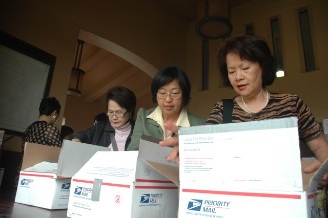 SCHOFIELD BARRACKS, Hawaii - (From left to right) Anna Doi, Sue Chen and Julie Rohrer, all members of the North America Taiwanese Women's Association, prepare Valentine's Day care packages for 25th Infantry Division and 3rd Infantry Brigade Combat Team Soldiers at Schofield Post Office, Feb. 3.