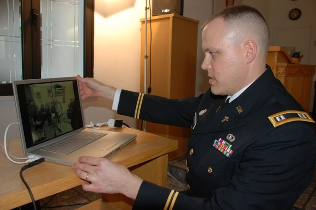 Chaplain (Maj.) Kelly Porter tests the audio on a video teleconference system with his family back in Kentucky before his promotion ceremony six time zones away.