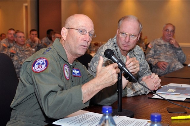 Air Force Gen. Victor E. Renuart Jr., commander of U.S. Northern Command and North American Aerospace Defense Command, (left) and Air Force Gen. Craig R. McKinley, chief of the National Guard Bureau, attend a National Guard workshop in Hilton Head, S.C., to discuss preparations for the 2009 hurricane season.