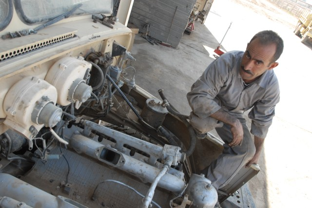 An Iraqi Soldier takes a moment's rest from working on a Soviet-made heavy truck at the Taji Wheel Level Three Maintenance facility on the Iraqi operated side of Camp Taji, Iraq on Feb. 12. (U.S. Army photo by 1st Lt. Ray K. Ragan)