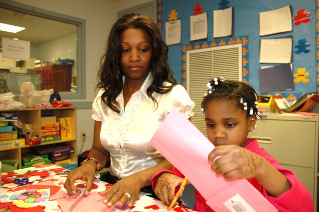 FORT MCPHERSON -- Staff Sgt. Jevongela Epperson, the U.S. Army Forces Command travel NCO for the FORSCOM commanding general, makes crafts with her daughter, Zaria.