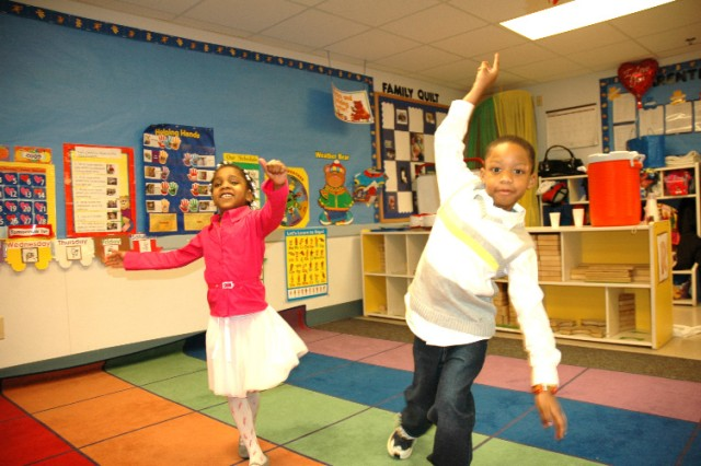 FORT MCPHERSON -- Zaria Agee (left) cuts a rug with Kamaal Stinson (both 5) at the Child Youth Services Center, Bldg. 400, Feb. 13 at the CYS-sponsored child and parent dance.