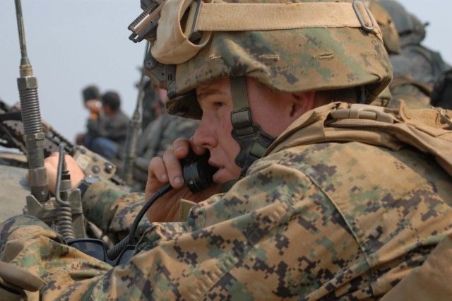 A Marine Forward Observer calls for fire during the Combined Arms Live Fire Exercise Feb. 16.