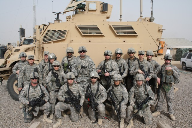 Brig. Gen. Michael J. Lally, commanding general of the 3rd Sustainment Command (Expeditionary), poses for a photo with members of his personal security detail prior to departing the 10,000th MRAP ceremony in Baghdad, Iraq on Feb. 20. (U.S. Army photo by Master Sgt. Max Hamlin)