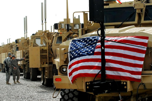 Mine-resistant, ambush-protected vehicles sit in a row on the Camp Liberty, Iraq, fielding site, Feb. 20, 2009. The day marked the introduction of the 10,000th vehicle into Iraq by U.S. Central Command.