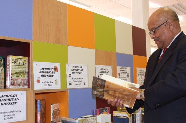 Lawrence N. Self, director of the Office of Equal Opportunity and Diversity Management for the National Institutes of Health, peruses a display celebrating Black History Month at the Ledward Library in Schweinfurt, Germany, Feb. 12.
