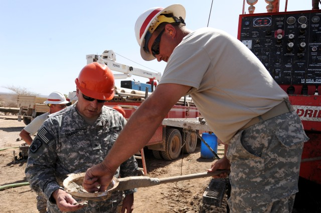 Brig. Gen. Robert A. Harris (left), Commander, 194th Brigade and Sgt. Roy Hayes inspect soil consistency while drilling a well in Dikhil, Djibouti, Feb. 20. Brig. Gen. Harris was on a five-day trip to Djibouti to visit his troops stationed here. Sgt. Hayes and the rest of the 775th Well Drilling Detachment fall under the 194 Bde., a part of the Tennessee Army National Guard. The detachment is deployed to Africa in support of Combined Joint Task Force - Horn of Africa, the primary mission of which is to help Africans solve African challenges.