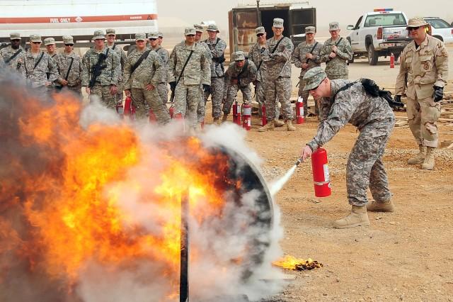 Soldiers train on proper fire-fighting skills