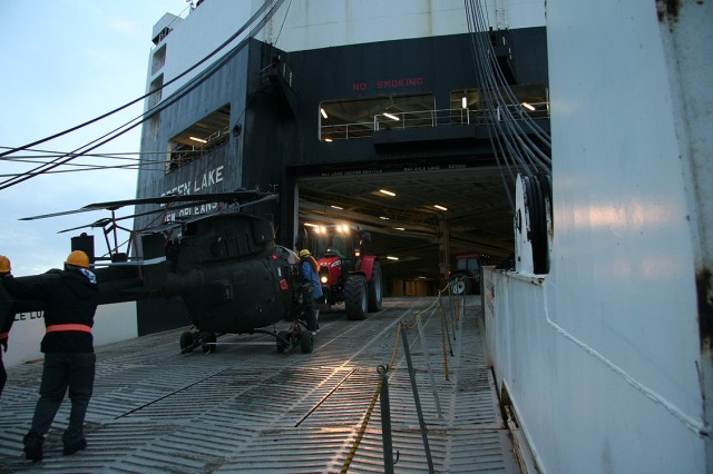 The TASM-E begins loading aircraft aboard ship well before dawn.