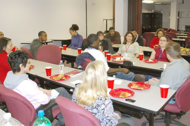 Minority College Relations Program interns enjoy some pizza and camaraderie during a luncheon held in their honor Jan. 23 in Building 390, Rock Island Arsenal, Ill. The winter-spring semester internship runs January through April and enables participants to gain valuable experience working for the federal government.