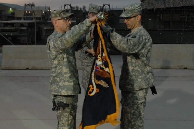 "CAMP TAJI, Iraq - Lt. Col. Mark O'Hanlon (left), of Wallingford, Pa., commander of the 1st Battalion, 111th Infantry Regiment, 56th Stryker Brigade Combat Team, Pennsylvania National Guard, unfurls the battalion colors with the Command Sgt. Maj. Mark Deutsch of Mohnton, Pa. Headquartered at Plymouth Meeting, Pa. the unit traces its lineage to the ""Associators"" unit raised by Ben Franklin to defend Philadelphia from French privateers."
