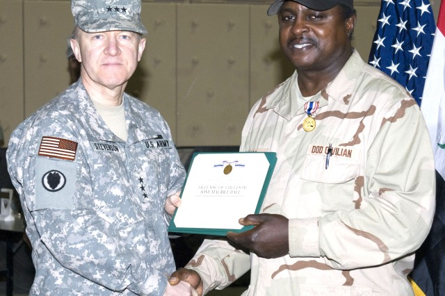 Hall receives Defense of Freedom award