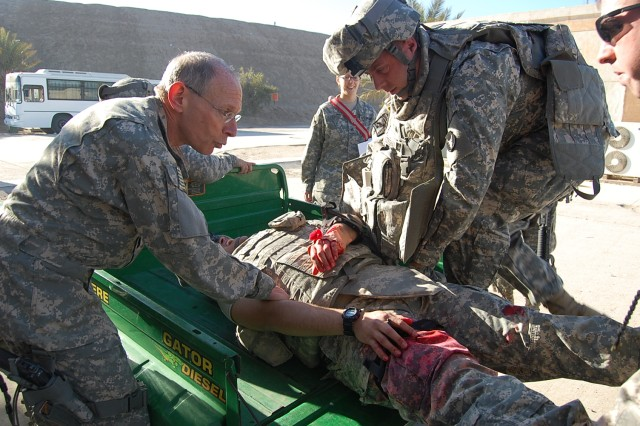 Col. Lionel M. Nelson, Task Force 449 Brigade Surgeon, assists Soldiers during the Mass Casualty training exercise January 8 in Baghdad. The exercise is intended to help Soldiers learn how to react in case of a medical tragedy. (U.S. Army photo by Pfc. Jasmine N. Walthall)