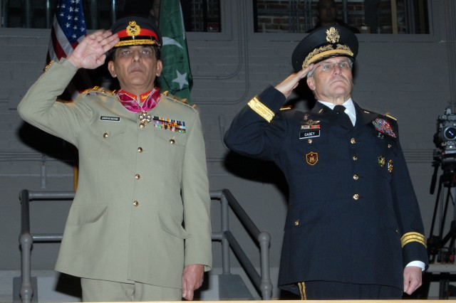 Gen. Ashfaq Parvez Kayani, the Chief of Staff of the Pakistan Army, and Gen. George Casey, the Chief of Staff of the Army, salute during the Pakistani national anthem at Fort Myer, Va., during an arrival ceremony for Kayani.  At the ceremony, Casey awarded Kayani the Legion of Merit for his contributions to the Pakistani Army.