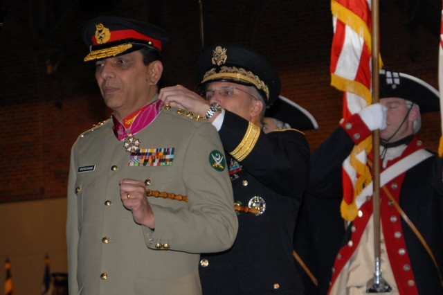 Gen. George Casey, Chief of Staff of the Army, places the Legion of Merit around the neck of Gen. Ashfaq Parvez Kayani, the Chief of Staff of the Pakistan Army, at a full honors arrival ceremony held in Kayani's honor at Fort Myer, Va.