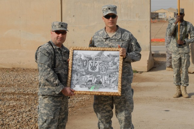 CAMP TAJI, Iraq - Lt. Col. Michael Curran (left), commander of the 328th Brigade Support Battalion, 56th Stryker Brigade, Pennsylvania National Guard, receives a framed print from Lt. Col. Mark Collins, commander of the 2nd Brigade, 25th Infantry BSB. Collins presented the print during a turnover of authority ceremony Feb. 19 on Camp Taji, Iraq, north of Baghdad.