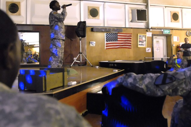 """BAGHDAD - Sgt. Aliesha Turner, a native of Midway, Ala., Division Special Troops Battalion, 1st Cavalry Division, sings the event winning song she wrote; Me and You, at the """"Night at the Apollo"""" talent show hosted by the Brigade Special Troops Battalion, 2nd Heavy Brigade Combat Team, 1st Infantry Division, at Camp Liberty Feb. 20."""