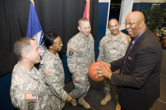 During a brief moment following the Black History Month program, guest speaker Nevil Shed shares a few basketball techniques with some of the depot leadership.  From left to right, Anniston Chemical Activity Commander Lt. Col. Andrew Herbst, Anniston Army Depot Commander Col. S. B. Keller, Anniston Munitions Center Commander Lt. Col. Duncan MacMullen and Depot Sergeant Major Tony Butler.