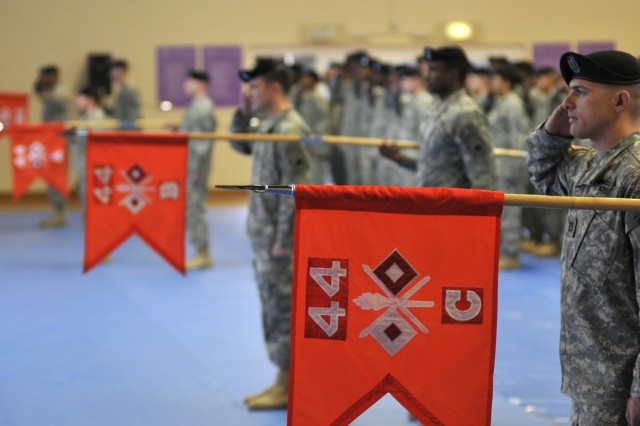 Cpt. Jeffrey Byrd, commander, Company C, 44th Expeditionary Signal Battalion, and other commanders salute during the uncasing ceremony held at the Benjamin Franklin Village Sports Arena. The uncasing of the colors signifies the battalion's official arrival from their 15-month deployment in support of Operation Iraqi Freedom.