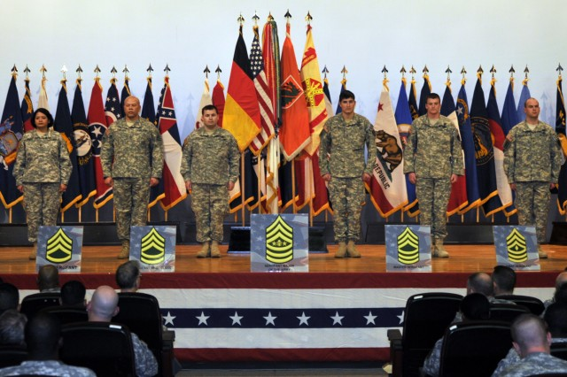Sgt. 1st Class Dolores Rivera, 52nd Signal Battalion, Sgt. 1st Class Keith Cade, 509th Signal Battalion, and Staff Sgt. Gabriel Burkman, Staff Sgt. Beau Martindale, Staff Sgt. Benjamin Wagner, and Sgt. Nathan Williams of the 720th EOD Company, are honored for their accomplishments and bravery during the Year of the Noncommissioned Officer launch held at Schuh Theater, Sullivan Barracks.