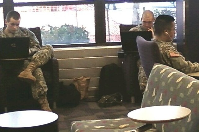 Soldiers at the new Fort Gordon, Ga., Recreation Center use WiFi and multi-player online games.