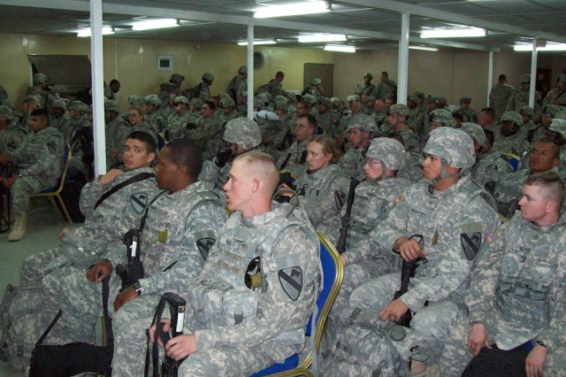 Soldiers from 2nd Brigade Combat Team, 1st Cavalry Division, sit through a briefing after arriving at Forward Operating Base Warrior, Kuwait, Iraq, Jan. 25. The Soldiers will be working with the local population to provide a more-stable environment in the province. Soldiers will be working with Iraqi police, the Iraqi Army and other groups to accomplish their mission.