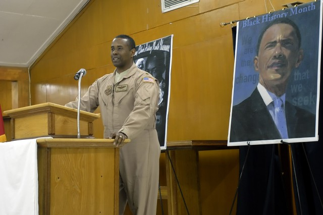 """BAGHDAD – Maj. Kingston Lampley, a native of Newark, N.J., air advisor to the Iraqi Air Force Air Operations Center, address the audience of the """"African-American/Black History Month"""" Observance at Camp Liberty Feb. 22. Lampley, who was the special guest speaker, spoke about the accomplishments of many successful African Americans, including President Barrack Obama, the 44th U.S. president."""
