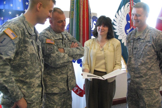 Laura Ayers reviews the Reintegration Action Plan with, from left, AMCOM's Capt. Peter Schmitt, commander's aide; Command Sgt. Maj. Ricky Yates and Capt. Shane Scott, executive officer. RAP is a tool for returning servicemembers and veterans who need information and resources to develop an action plan for reintegration after a wartime deployment. RAP is free to all servicemembers and veterans.