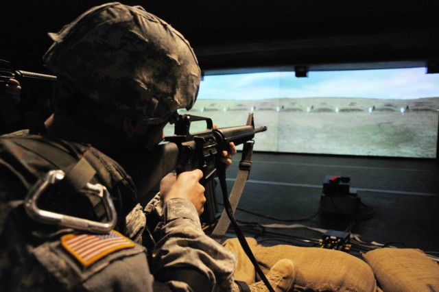 """Simulators like the Engagement Skills Trainer help Soldiers practice proper marksmanship technique.  """"These Soldiers are trained from day one much better than we NCOs were several years back, due to the realism of combat-tested leadership, technology, real-world scenarios, and some common sense,"""" Church said."""
