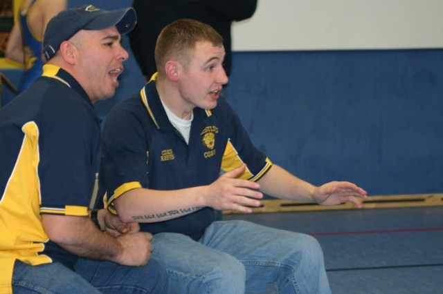 NCO volunteers as youth wrestling coach