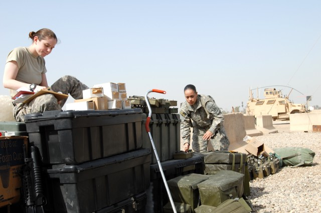 "CAMP LIBERTY, Iraq - After arriving to Camp Liberty, Spc. Nicole Delia (left), of Clifton Park, N.Y. and Pfc. Stephanie Malave, of Waterbury, Conn., both of the 340th MP Co., 91st MP Battalion, 8th MP Brigade, inventory chemical, biological, radioactive and nuclear equipment from the unit and additional gear from Forward Operating Base Rustamiyah, also known as ""Camp Rusty"" Feb. 17."