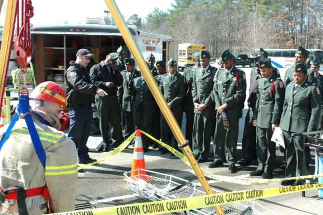 Haidet, a fireman on the Fort Gillem hazardous materials response unit, speaks with students about his job.  The event allowed students to see careers that were open to them and give them options they may not have previously thought about.