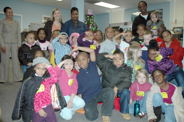 FORT MCPHERSON, Ga. -- Toomer Elementary School students visited Fort McPherson Feb. 20 to meet Col. Deborah Grays, garrison commander, as part of a school liason office function. By taking a vested interest in area schools, the Fort McPherson community is helping to give back and improve the quality of its neighbors' lives, said Camellia Jefferson, the garrison's School Liaison Officer.
