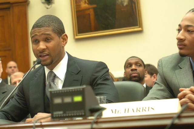 Usher Raymond IV, recording artist and chairman of Usher's New Look Foundation, speaks to Congress on empowering youth through national service.  Seated to his left is James Harris, one of his youth participants, and seated to his right is former U.S. Sen. Harris Wofford of Pennsylvania.