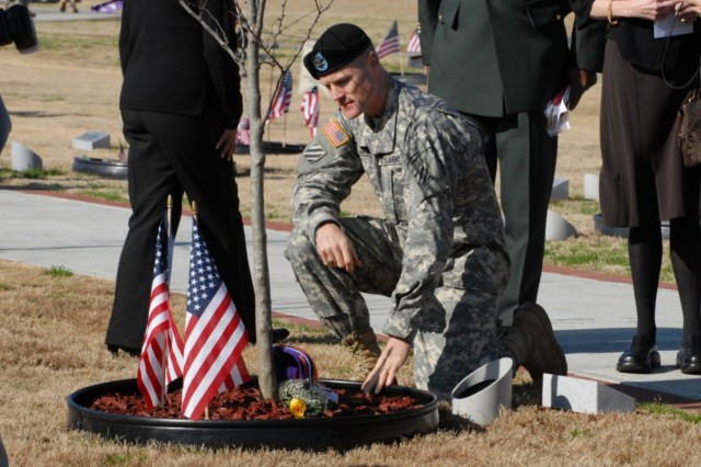 Col. Thomas James, 4th BCT commander, takes a moment at Sgt. Adam Wenger's Eastern Redbud Tree following the tree dedication ceremony Feb. 19 at Warrior's Walk.