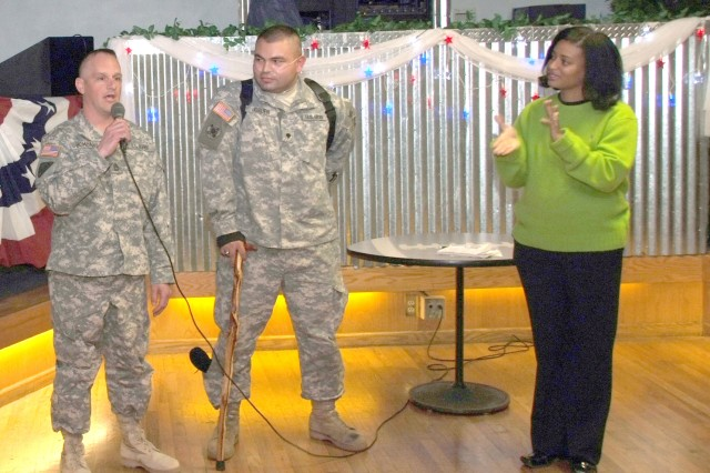 "FORT CARSON, Colo.-Latoya Lucas, right, applauds the story of a wounded Soldier at Fort Carson's Joe Gmelch Wounded Warrior Welcome Home social. Lucas hosts the socials quarterly to welcome home Soldiers who return to Fort Carson before their deployed unit redeploys. Lucas recently wrote a book about her experiences recovering from injuries she sustained in Iraq entitled, ""The Immeasurable Spirit: Lessons of a Wounded Warrior about Faith and Perserverance."""
