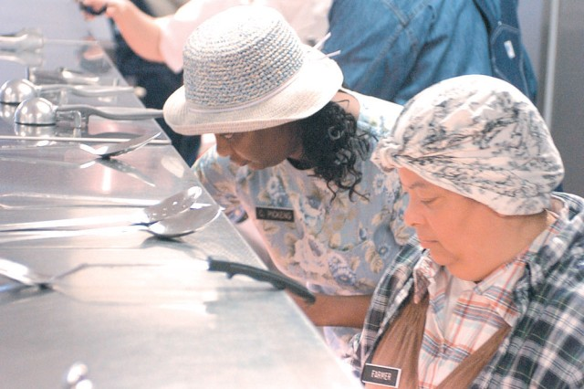 """Food service workers dress in 19th century costumes at Sustainment Brigade's dining facility Feb. 23 in honor of Black History Month."""""""
