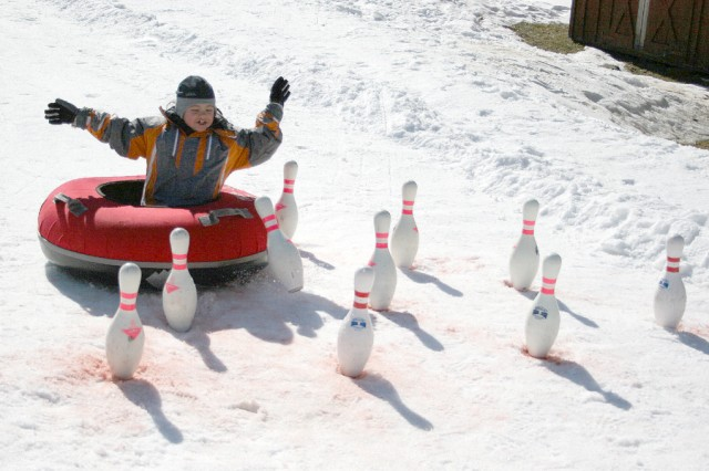 Seven-year-old Aubrey Matalon tries snow tubing at the fifth-annual Polar Fest Feb. 21.
