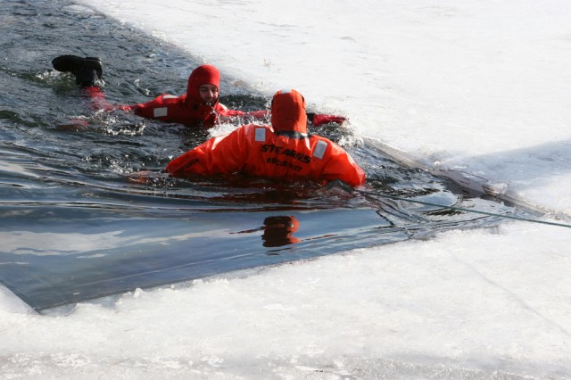 The West Point Fire Department completed ice rescue training at Lusk Reservoir Monday and Tuesday. Firefighter James Rohner rescues Mike Aniello during  the firefighters' annual recertification. Fire Chief Curt Krieger said ice rescues are rare, but because of the many lakes and ponds on West Point and in the surrounding area, the firefighters need to be able to respond to ice-related incidents. They wear waterproof outfits of sealed cell neoprene or nylon shell and need to practice moving and maneuvering in them. To be certified, firefighters must perform one self-rescue and two victim rescues, using various techniques and equipment.