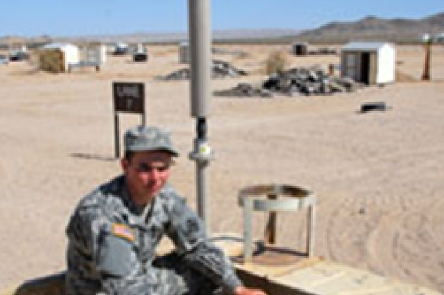 Pfc. Bryan Thomas, Charlie Co., 854th Engineering Battalion, pulls out the Duke CREW system that jams radio-controlled IEDs.