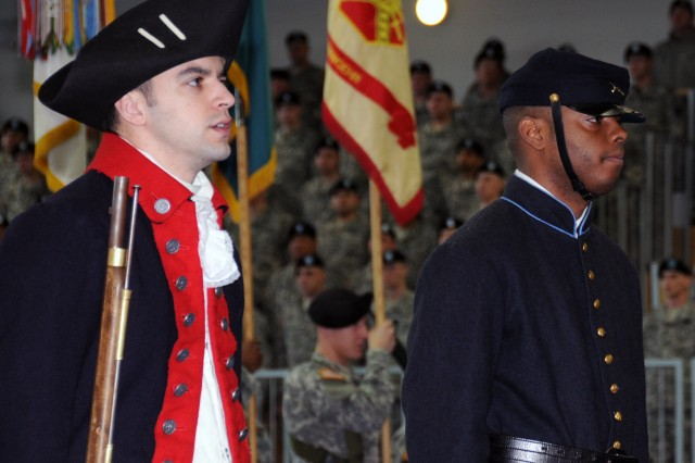 Sgt. Kenneth Adams (left) and Staff Sgt. Anthony Vernon (right) display the uniforms worn by noncommissioned officers during the Revolutionary and Civil Wars as part of a 7th Army Joint Multinational Training Command ceremony in Grafenwoehr, Germany celebrating the Year of the NCO. (Photo by Spc. Gerald Wilson)