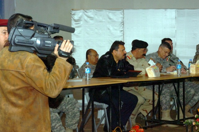 Maj. Gen. Abdul Ameer, commander, Iraqi Army 12th Infantry Division (left), and Maj. Gen. Robert L. Caslen, Jr., commanding general, Multi-National Division - North, address a crowd of U.S. and Iraqi military forces and members of the Iraqi media during a press conference held at the Iraqi Army 12th Inf. Div. headquarters in Kirkuk province to officially transfer authority over the Sons of Iraq from the U.S. to the Iraqi government, Feb. 25. (U.S. Army photo by Pfc. Jesus J. Aranda, Task Force Lightning Public Affairs Office)