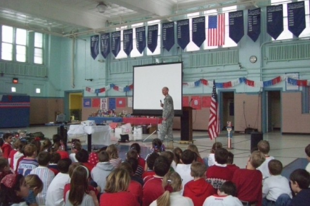 Sgt. 1st Class Barry Giles addressing students at St. Mary school in Mt. Clemens, MI.