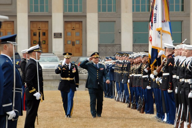 Lt. Gen. Jean T. Kahwagi, Chairman of Joint Chiefs of Staff of Lebanon, and Lt. Col. Michael F. McNally, Commander of Troops, present arms as they pass colors in formation in an Armed Forces Full Honor Arrival at the Pentagon, Arlington, Va.