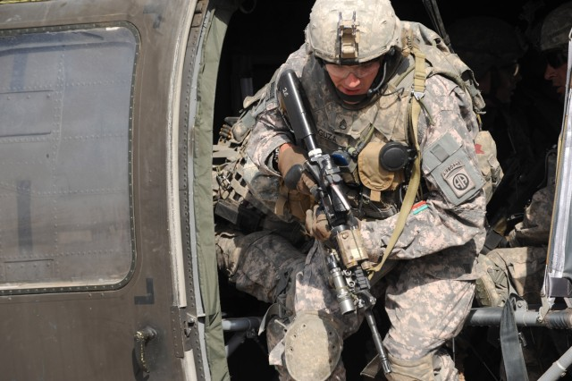 FORWARD OPERATING BASE LOYALTY, Iraq - Staff Sgt. Matthew Guza, a native of Cameron, N.C., assigned to Troop B, 5th Squadron, 73rd Cavalry Regiment, 3rd Brigade Combat Team, 82nd Airborne Division, Multi-National Division-Baghdad, exits an UH-60 Blackhawk helicopter during an aerial response force training event Feb. 25 at Forward Operating Base Loyalty in eastern Baghdad.