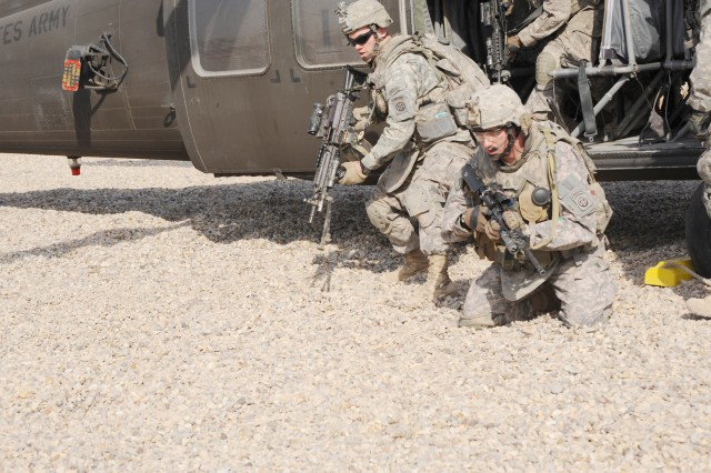 FORWARD OPERATING BASE LOYALTY, Iraq - Paratroopers assigned to Troop B, 5th Squadron, 73rd Cavalry Regiment, 3rd Brigade Combat Team, 82nd Airborne Division, Multi-National Division-Baghdad, exit a UH-60 Blackhawk helicopter and position themselves in the prone fighting position during a aerial response force training exercise Feb. 25 at Forward Operating Base Loyalty in eastern Baghdad. The training event allowed Paratroopers to hone their skills on loading and exiting helicopter procedures.