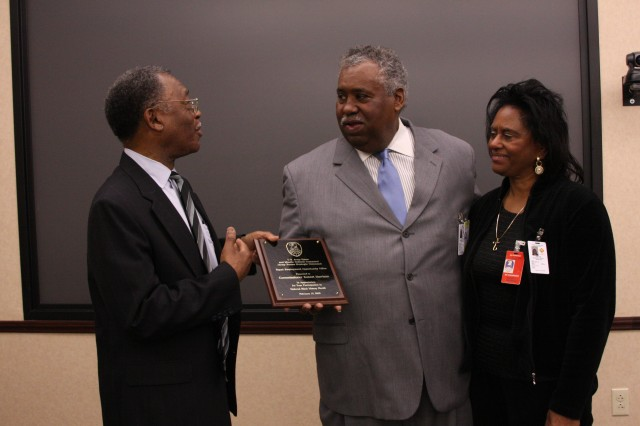 "Melvin Kelley, director, U.S. Space and Missile Defense Command/Army Forces Strategic Command Equal Employment Opportunity Office, left, presents Robert C. ""Bob"" Harrison, Madison County District Six commissioner, and award of appreciation for being the guest speaker at USASMDC/ARSTRAT's African-American History Month celebration Feb. 12. To the right is Harrison's wife of 42 years, Dr. Izora Harrison."