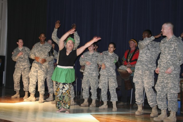 A dancer from the dance group Mnwendo leads a group of Soldiers Feb. 19 during the Black History Month celebration at the Hacienda Recreation Center.