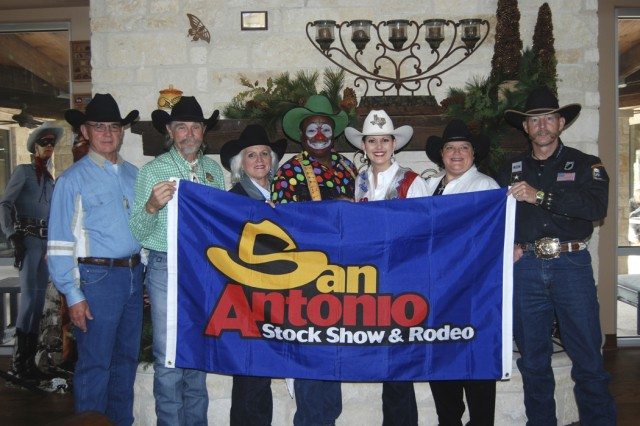 San Antonio Stock Show and Rodeo volunteer, Bud Cheatham; Buck Taylor; Jackie Van de Walle, Assistant Vice President, San Antonio Stock Show and Rodeo; Leon Coffee, rodeo clown; Avery Gonzales, Miss Rodeo Texas 2008; Penny Riles, member of the Cowboy Church committee; and retired Army Lt. Col. Ron Benton, 5th Recruiting Brigade Contract Cowboy Recruiter, who tells the Army story, take time out from rodeo activities to visit with wounded warriors and their families at the Warrior and Family Support Center.